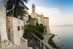 The town of Rab, Croatian tourist resort famous for its bell towers. - stock photo