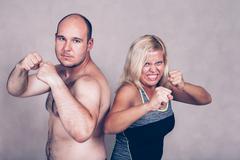 Aggressive couple ready to fight - stock photo