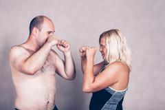 Shirtless man and woman going to fighting - stock photo