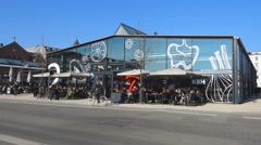 Torvehallerne, the covered food market halls in Copenhagen on a sunny afternoon Stock Footage