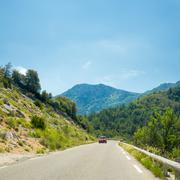 Nissan Micra car on background of French mountain nature landsca - stock photo