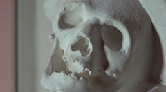 Human skull sculpture in a museum - zoom out - stock footage