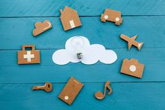 Cardboard web icons  and white cloud and a light bulb Stock Photos