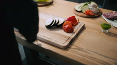 Chef cutting vegetables on a cutting board Stock Footage