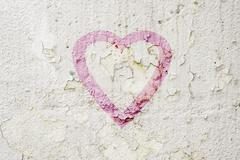 Grungy urban wall with painted heart - stock photo