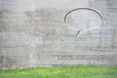 Speech bubble on concrete wall Stock Photos