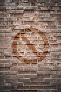 Grungy urban wall with forbidden sign Stock Photos