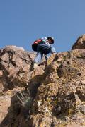 The tourist rises on a rock Stock Photos