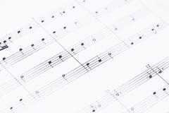 Music notes on paper in close up Stock Photos