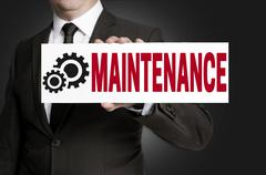 maintenance only sign is held by businessman - stock photo