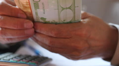 Close Up Of Man With Calculator Counting Money Euro - stock footage