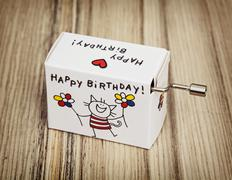 Music box with funny title happy birthday - stock photo