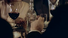 Friends chatting over dinner in a restaurant Stock Footage