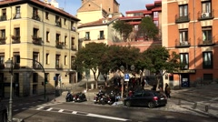 City Madrid in Spain road between buildings with cars and people who pass Stock Footage