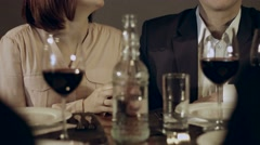 Friends tasting wine during dinner at the restaurant Stock Footage