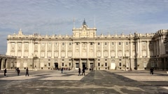 City Madrid in Spain visitors in front of historical complex of building Stock Footage
