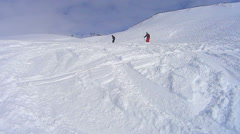 Skiing and watching the other happy skiiers Stock Footage