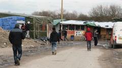 Refugees walking towards improvised refugee camp. Stock Footage