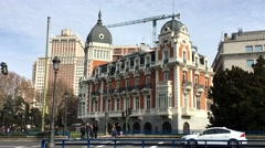 City Madrid in Spain road where go cars along the historical building Stock Footage