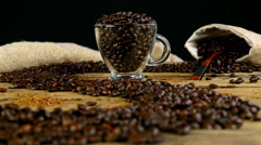 Path made with coffee beans on wooden table, changing the focus Stock Footage