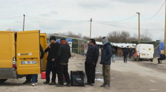 Refugees standing by supply van. Calais, France. Stock Footage