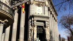 City Madrid in Spain entrance to the historical building with flag and statue Stock Footage
