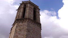 Camera pan from Ghotic spire to bell tower of Barcelona Cathedral - stock footage