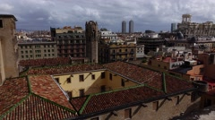 City roofs close view from top of Barcelona Cathedral, pan around and back Stock Footage