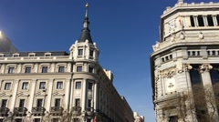 City Madrid in Spain urban street where go cars in downtown Stock Footage