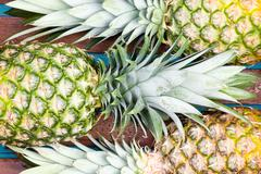 Three pineapple fruits close together - stock photo