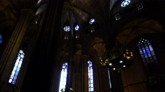 Barcelona Cathedral interior, low angle shot, arched roof, stained-glass windows Stock Footage