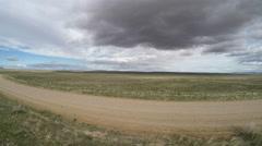 4K AERIAL: Dirt Road, Wide Open Plains, Utah Stock Footage