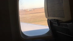 View from the window of airplane which take off - stock footage