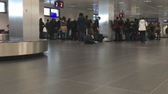 People with suitcase and luggage at baggage reclaim area of the airport Stock Footage