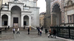 City Bergamo in Italy people walk in front of historical building Stock Footage
