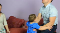 Happy Father raises the arms of his little son Stock Footage