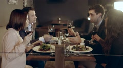 People communicate over dinner and drinking wine Stock Footage