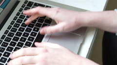 4k caucasian hands type quickly on a mac laptop on table - stock footage