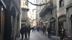 City Bergamo in Italy people walk throught passage way and observe landscape Stock Footage