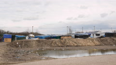 Refugee camp in Calais, France. Long pan shot. Stock Footage