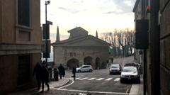 City Bergamo in Italy cars go on spiral road along the historical building Stock Footage