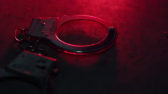 Police Arrest - Handcuffs on concrete with sirens - stock footage