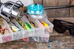 fishing tackles, lures and baits in boxes - stock photo