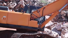 Excavator working on marble stone quarry Stock Footage