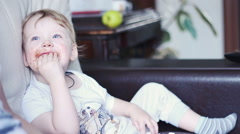 Little Boy Eating Chocolate And Smeared Mouth - stock footage
