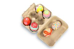 Colorful easter egg in pulp box on white background - stock photo