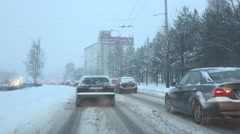 Traffic jammed and stuck in the city because of unexpected massive snowfall. 4K Stock Footage