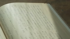 Japanese textbook on the table in the sunlight panoramic shot - stock footage