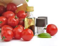 Cherry tomatoes and vinaigrette Stock Photos