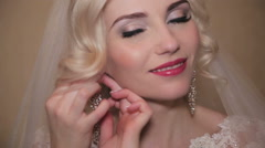 The bride wears a wedding earring - stock footage
